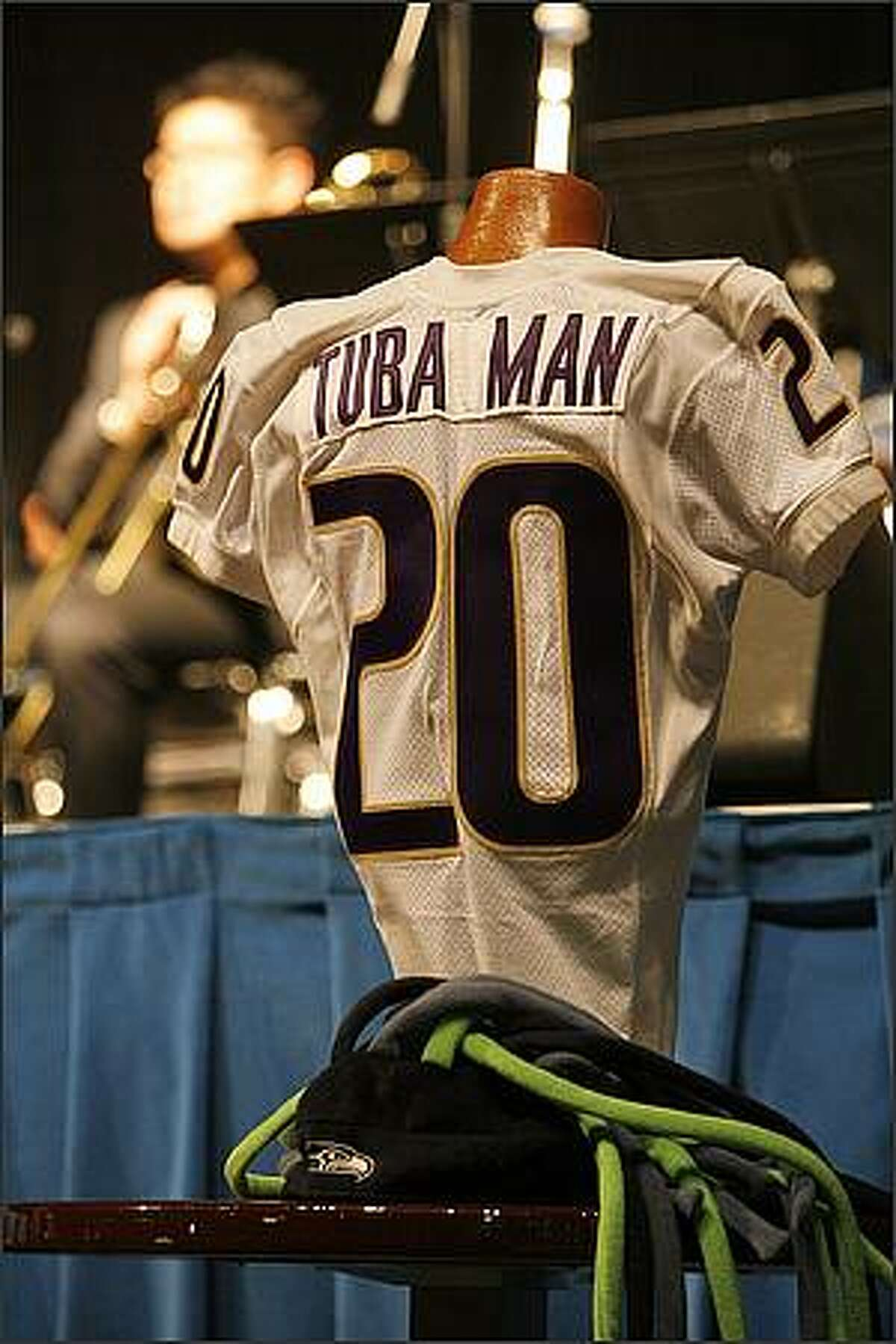 A University of Washington Huskies jersey is displayed during a memorial service for slain Tuba Man, Edward McMichael held at the Qwest Field Events Center in Seattle.