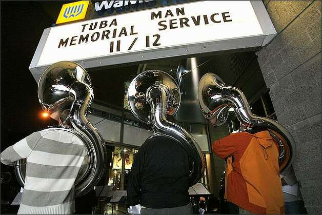 "Sounders FC band members and suzaphone players Keith Nagel, Miles Ward and Patrick Lamphere entertain mourners as they turn out for a memorial service for ""Tuba Man"" Edward McMichael held at the Qwest Field Events Center in 2008. Photo: Mike Urban, Seattle Post-Intelligencer"