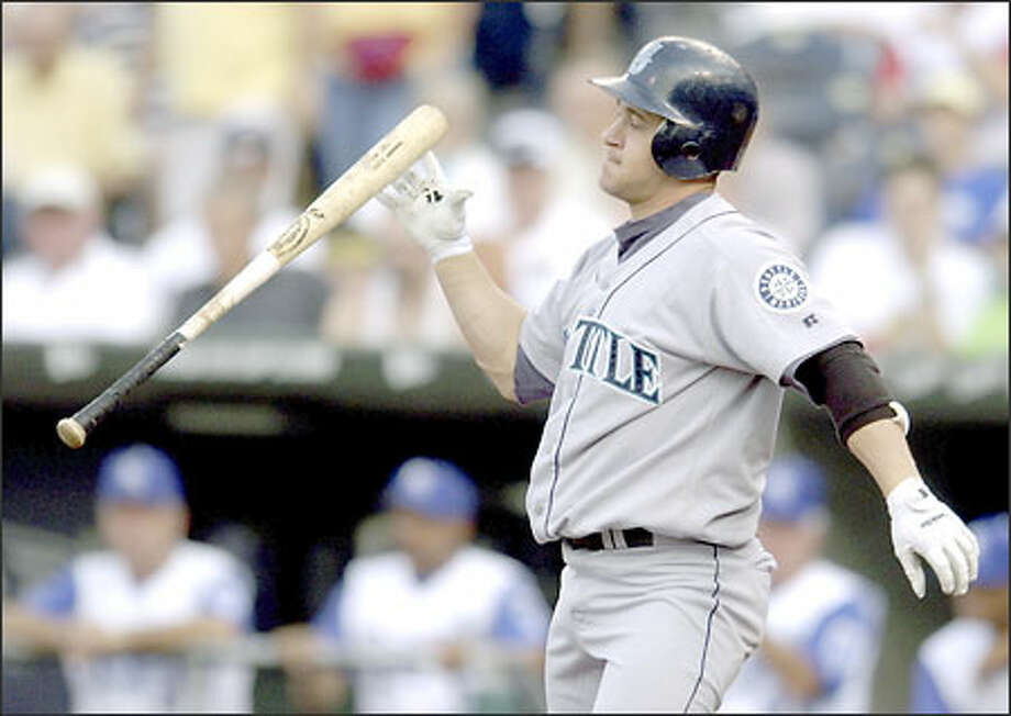 Bret Boone reacts after striking out with Ichiro on third. Seattle was 1-for-13 with runners in scoring position. Photo: Associated Press