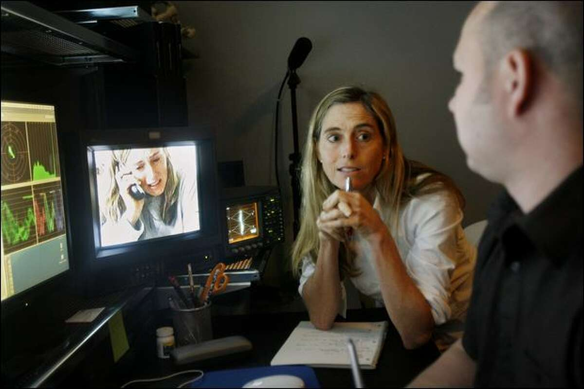 Delaney Ruston talks with Jim Golingo during an editing session at GolPost, a video/film post-production studio in Georgetown. She recently submitted the finished documentary to the Seattle International Film Festival.