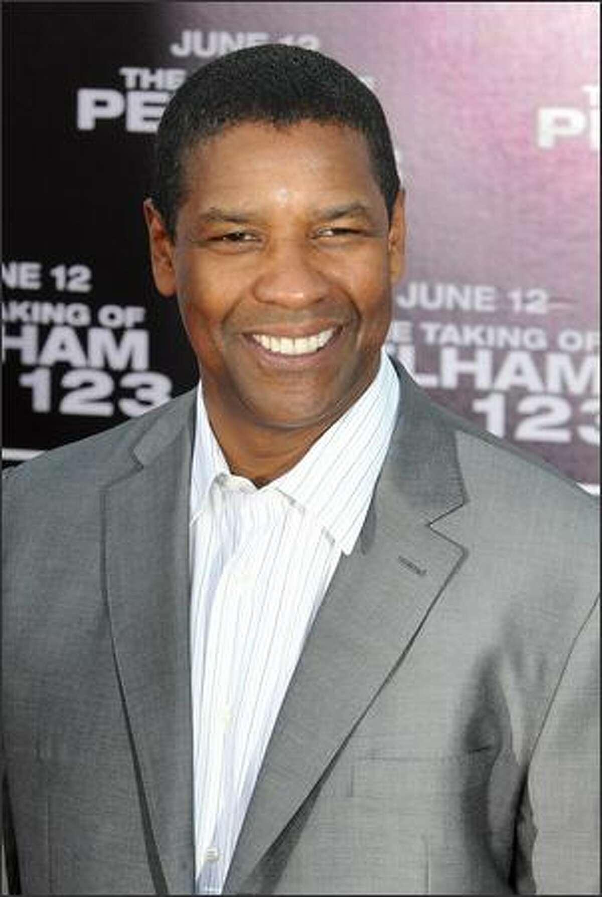 Cast member Denzel Washington arrives for the premiere of