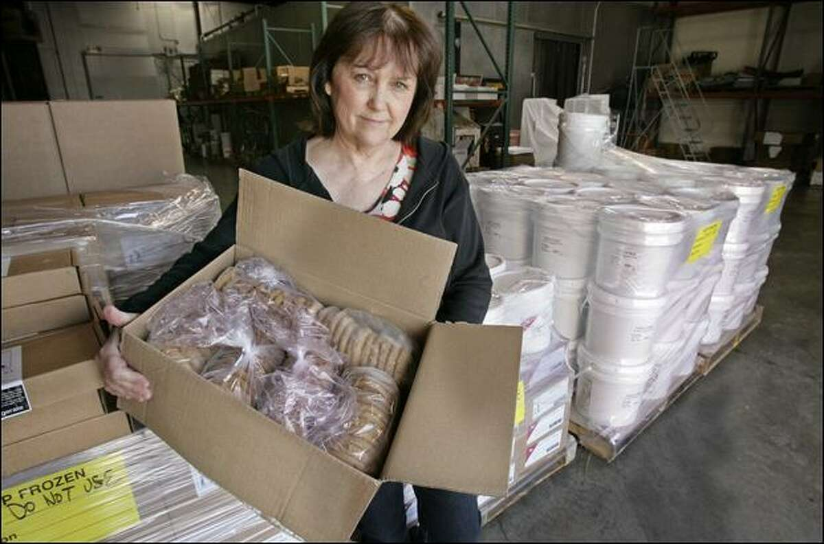Betsy Sanders holds a box of cookies made from a batch of peanut butter that was recalled at her company, Dough-To-Go Inc., in Santa Clara, Calif.