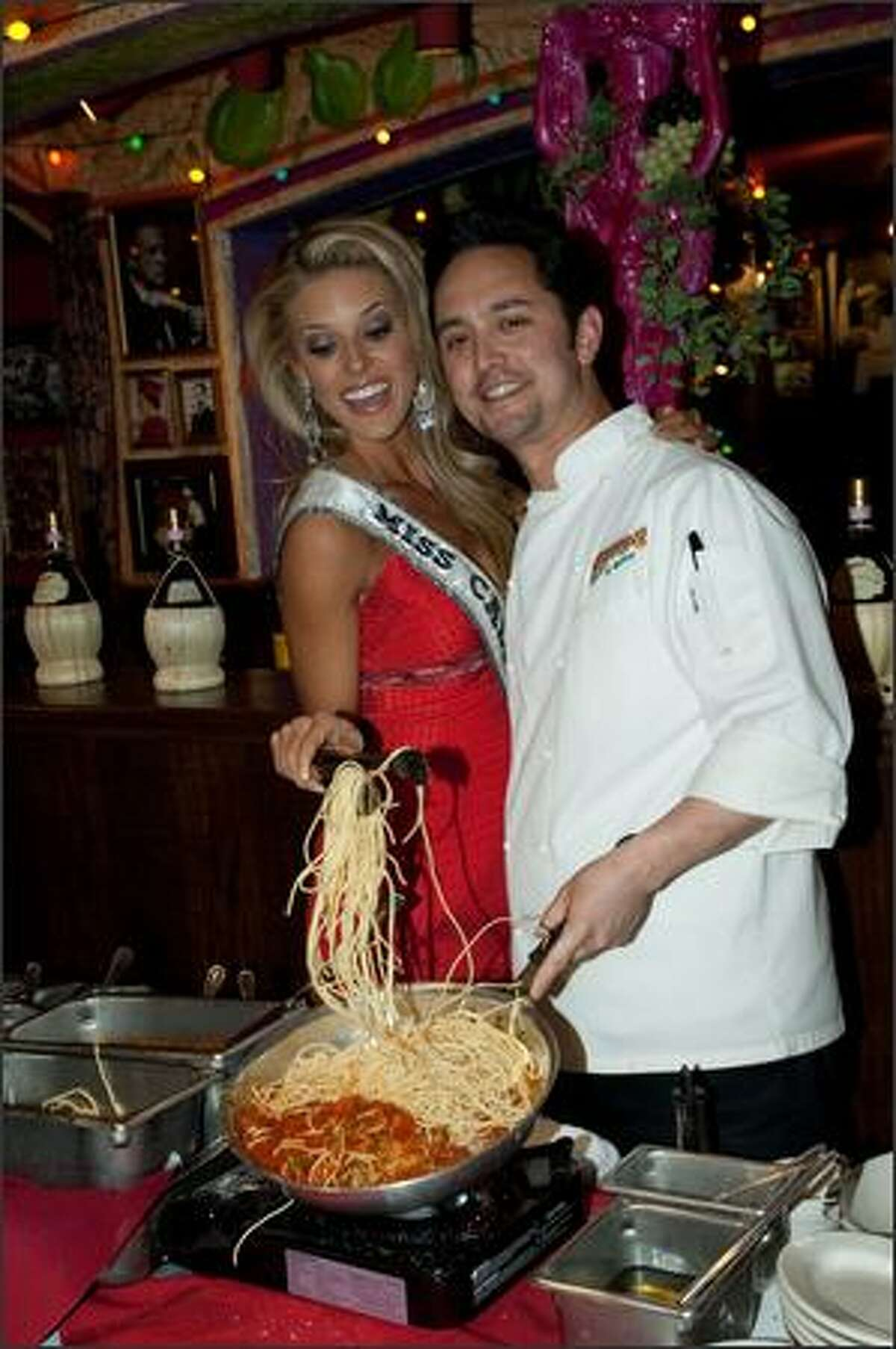 Carrie Prejean, Miss California USA 2009, cooks with Corporate Chef Michael Miyahara at Buca di Beppo.