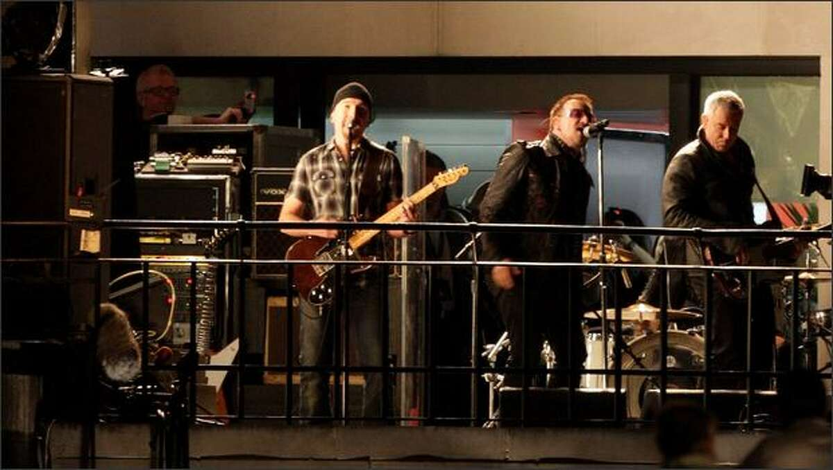 """Rock band U2 play a special live gig on top of the BBC building on Regent Street on Friday in London. The special performance exclusively for the BBC comes ahead of the release their 12th studio album, """"No Line On The Horizon,"""" on Tuesday."""