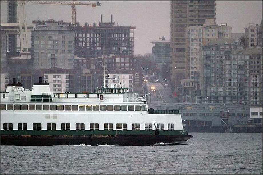 The ferry Tillikum crosses Elliott Bay on a rainy January day in 2008. Strapped for cash, policymakers are weighing whether to reinstate a vehicle tab tax to help pay for ferry operations in Washington state. Photo: Grant M. Haller/Seattle Post-Intelligencer