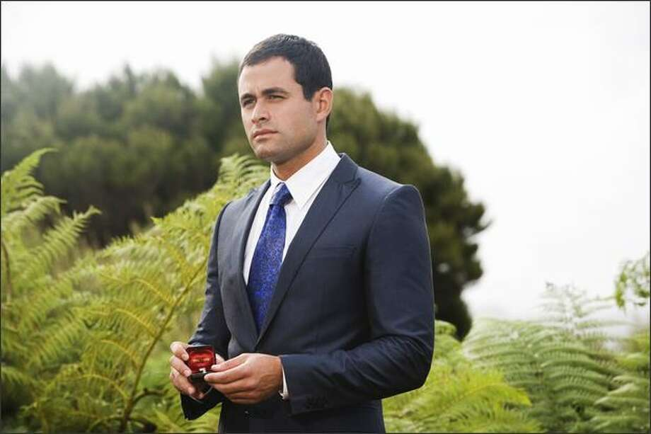 "In the finale of ""The Bachelor"" on Monday night , Jason Mesnick of  Kirkland agonized over his decision, bemoaning falling for two women at the same time. Photo: / ABC"
