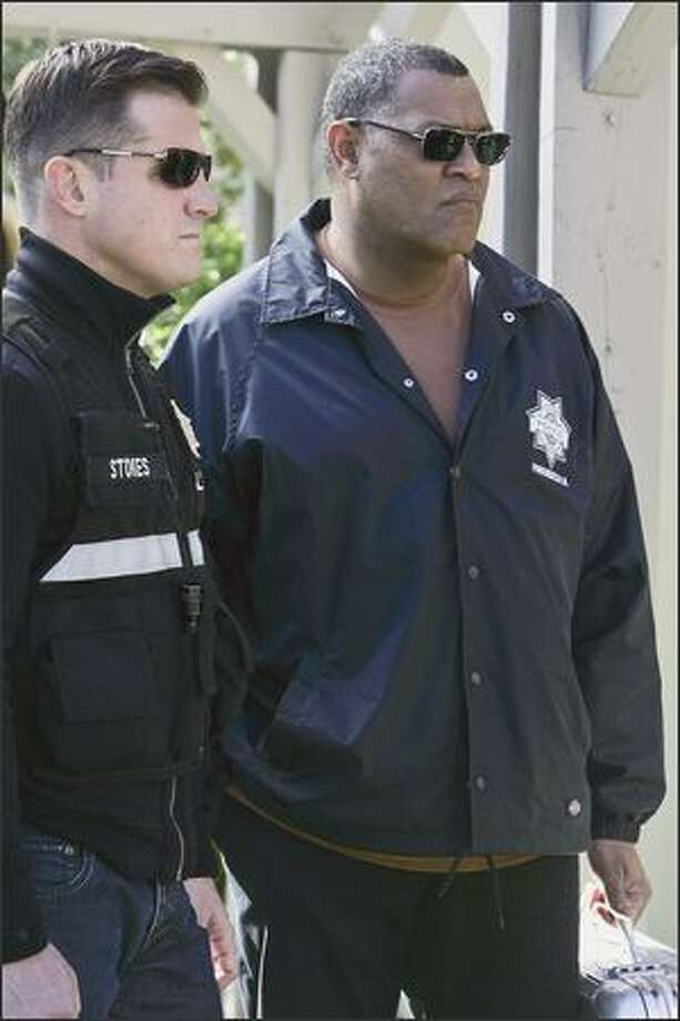 """Ray Langston (Laurence Fishburne, right) is the new sheriff in town on """"CSI,"""" working with Nick Stokes (George Eads). Photo: / CBS"""