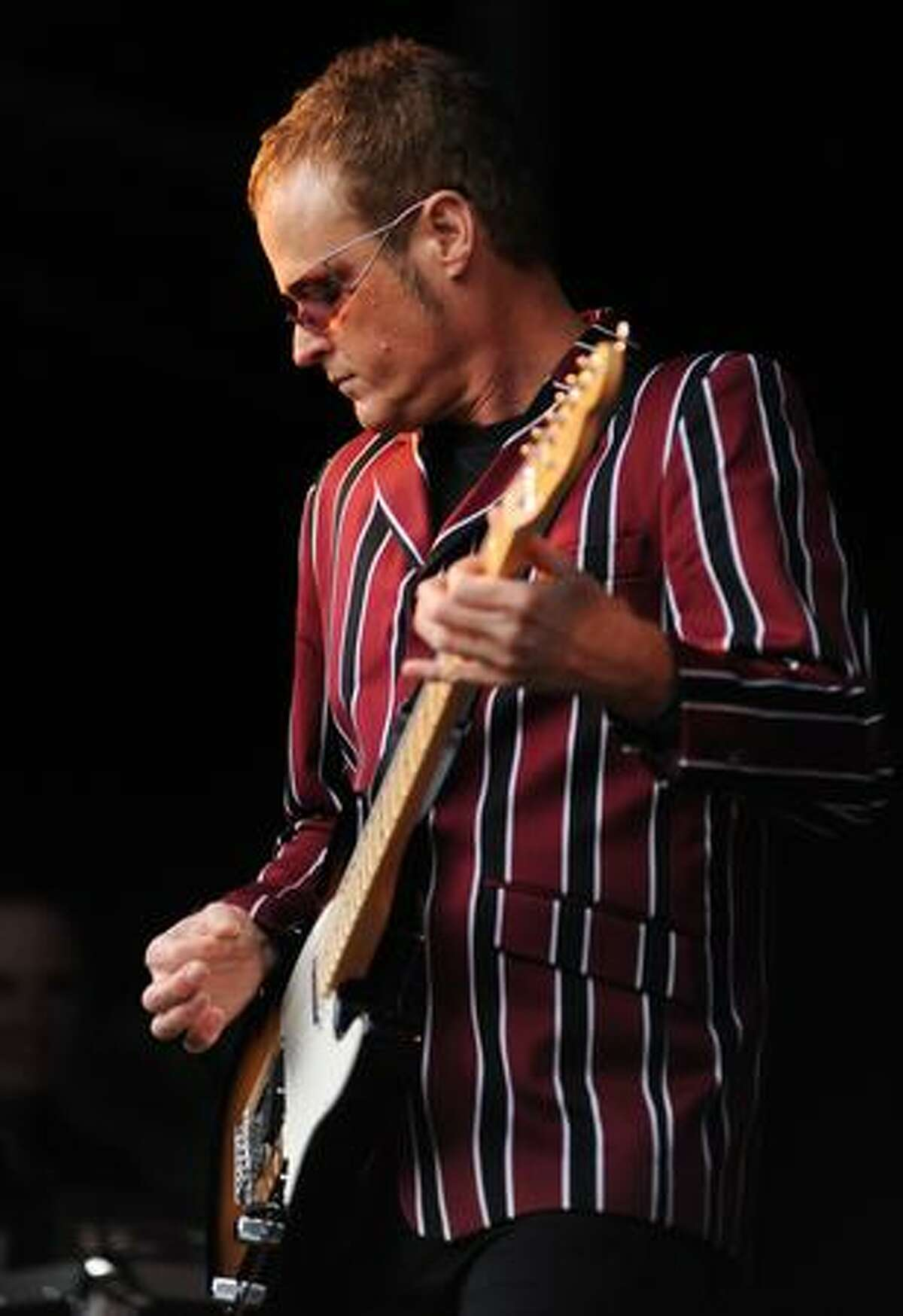 B-52s guitarist Keith Strickland performs at the Woodland Park Zoo.
