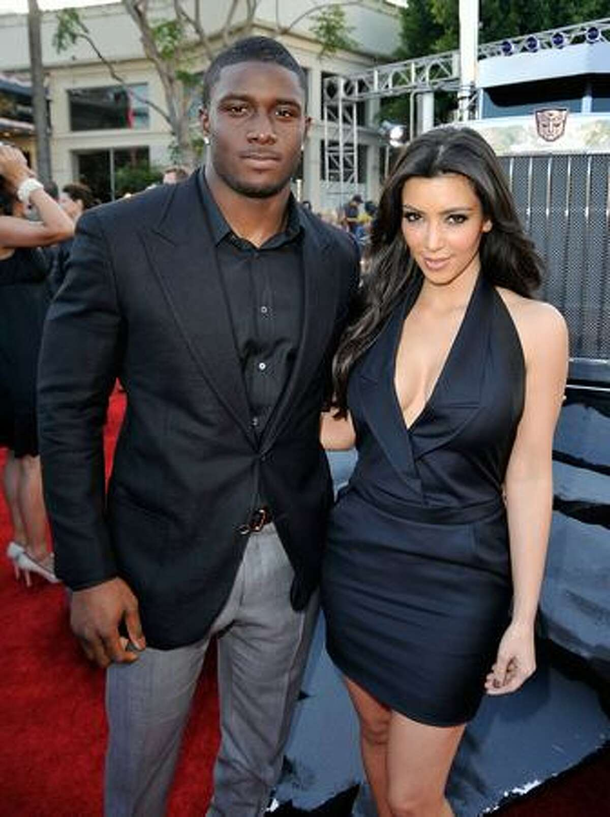 NFL player Reggie Bush (L) and TV personality Kim Kardashian arrive at the premiere of Dreamworks'
