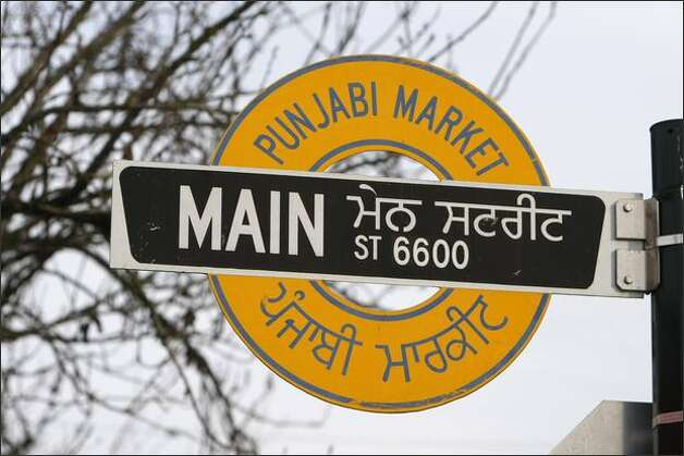 Street signs reflect the ethnic heritage of Vancouver's Little India. Punjabi Market is a South Vancouver neighborhood of five blocks along Main Street, stretching from 48th to 53rd avenues. Photo: Meryl Schenker/Seattle Post-Intelligencer