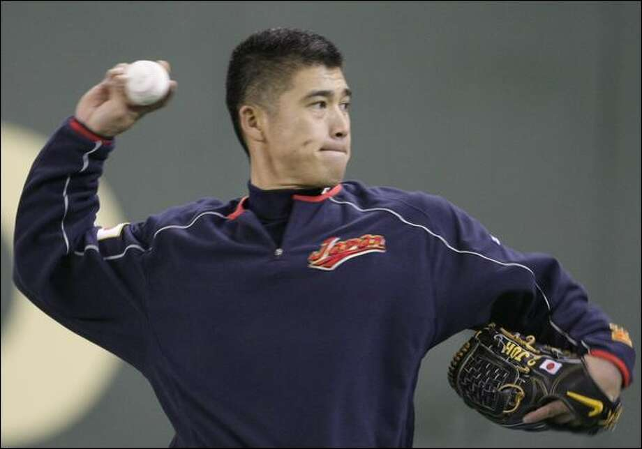 Kenji Johjima was expected to be the starting catcher for Japan, which opened the WBC early Thursday. Photo: Shizuo Kambayashi/Associated Press