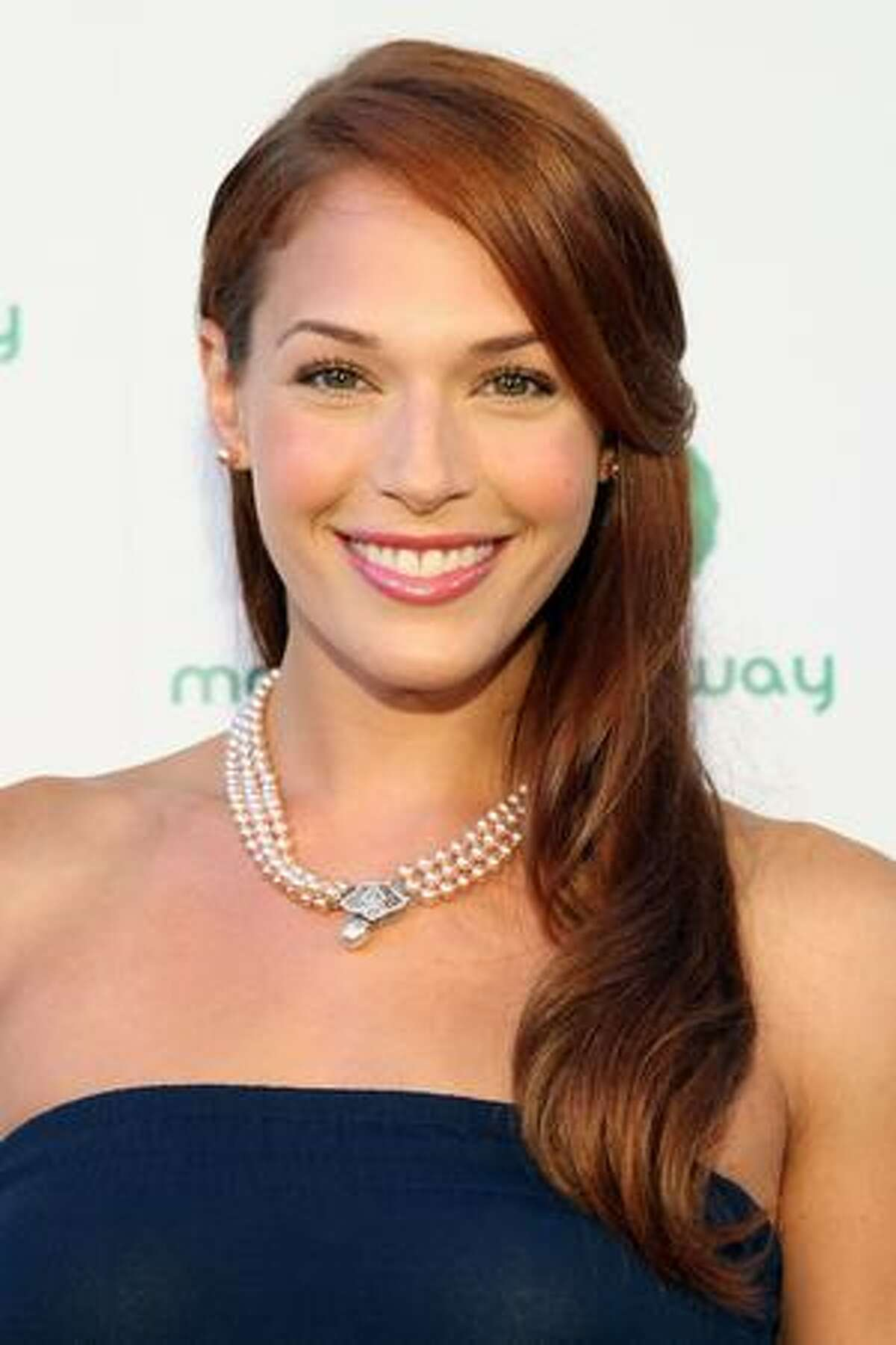 Actress Amanda Righetti attends.