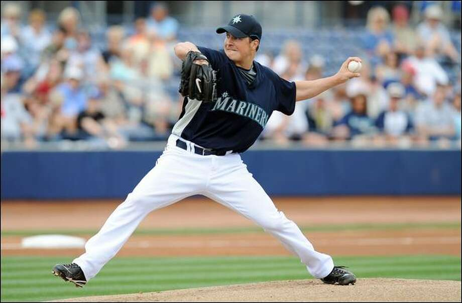 Mariners starter Erik Bedard looked sharp in his second appearance of spring training, pitching 2 2/3 shutout innings against the Angels. Bedard, who is returning from surgery to remove a cyst from his shoulder, said he felt fine. Photo: Lisa Blumenfeld/Getty Images