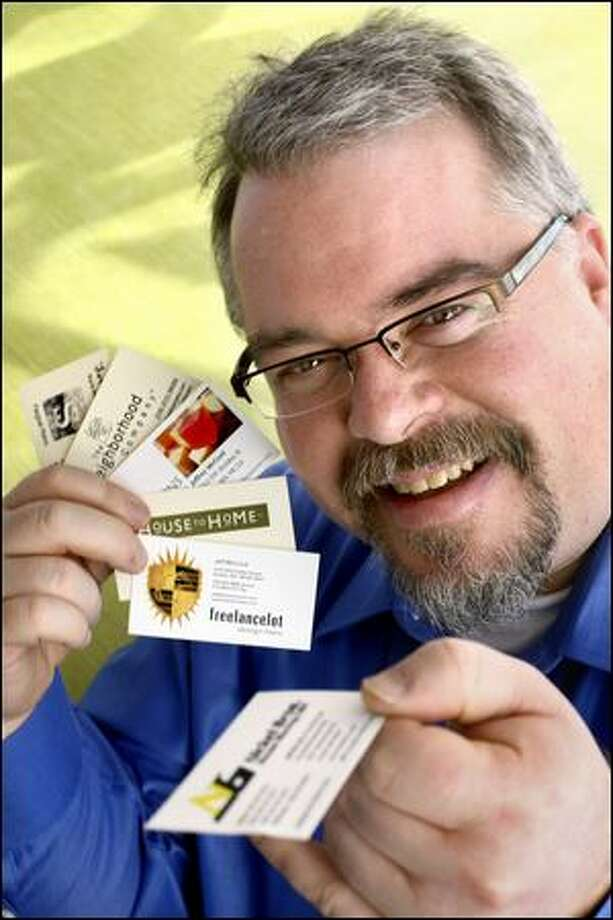 Contractor Jeff McCord carries six different business cards in his wallet, one for each of the professions at which he works to support his family. Photo: Andy Rogers/Seattle Post-Intelligencer