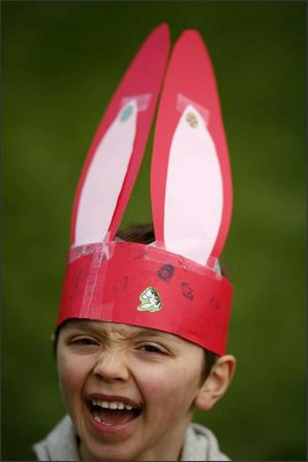 Emmett Kineman shows off the bunny ears he made during the Woodland Park Zoo's Bunny Bounce on Saturday in Seattle. The event included an Easter egg hunt and other activities for kids. Photo: Joshua Trujillo, Seattlepi.com