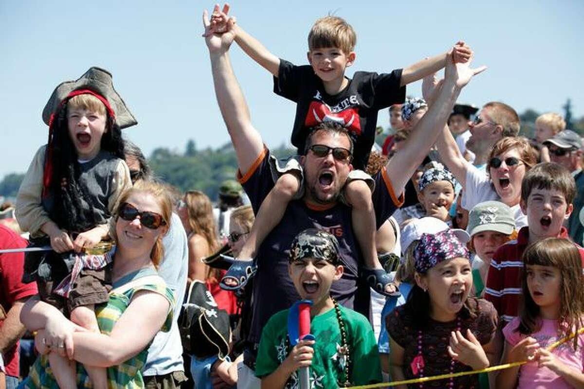 Spectators yell as loud as they can during the 2009 Seafair Pirates Landing at Alki Beach in Wes Seattle.