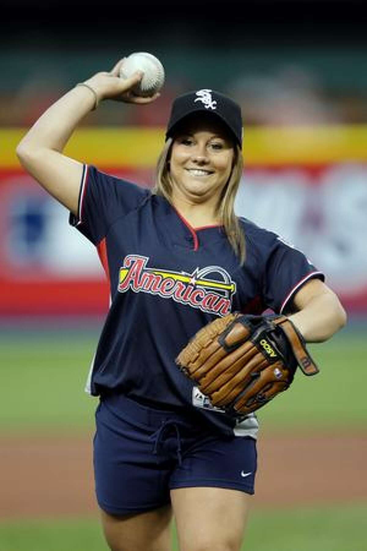 U.S. Olympian Shawn Johnson warms up prior to the game.