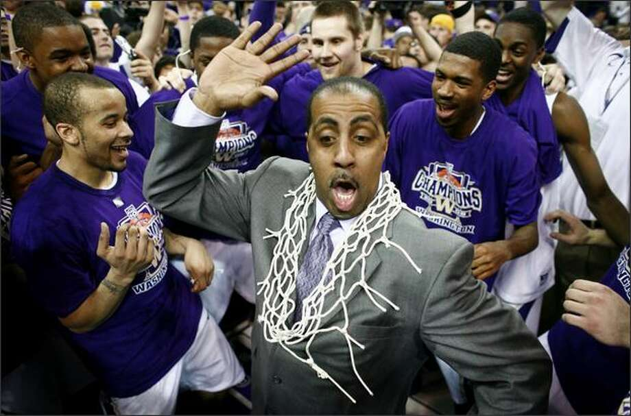 University of Washington coach Lorenzo Romar dances with his players after the team secured the Pac-10 championship with a 67-60 win over Washington State on Saturday at Hec Edmundson Pavilion in Seattle. Photo: Joshua Trujillo/Seattle Post-Intelligencer