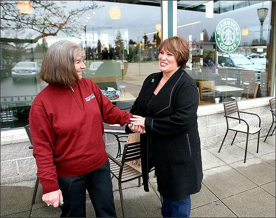 What Annamarie Ausnes, left, needed a year ago was a kidney. Not only did she receive one from donor Sandie Andersen, who at that time was a stranger. Ausnes also feels she gained a sister. The two women visit here at the Starbucks in the Proctor District of Tacoma. Photo: Scott Eklund/Seattle Post-Intelligencer