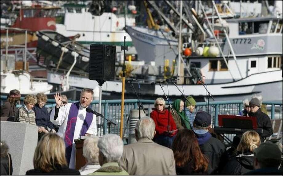 "Pastor Erik Wilson Weiberg of Ballard First Lutheran Church speaks Sunday during the 81st ""Blessing of the Fleet"" at Fishermen's Terminal. Photo: Dan DeLong/Seattle Post-Intelligencer"