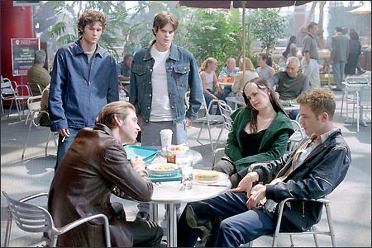 Pyro (Aaron Stanford), Iceman (Shawn Ashmore) and Rogue (Anna Paquin) react to the taunts of a pair of bullies (Glen Curtis, standing left) and Greg Rikaart.