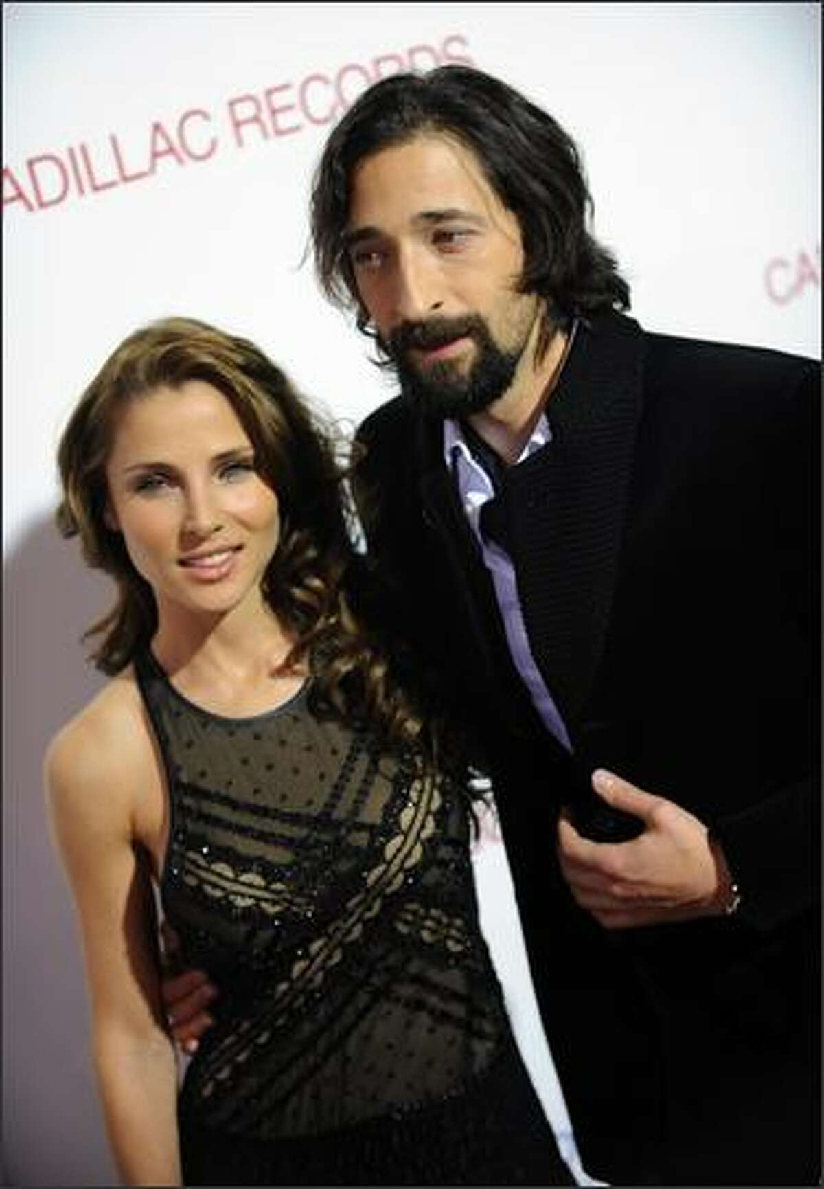 """Actor Adrien Brody arrives with his girlfriend, Spanish actress Elsa Pataky, for the Los Angeles premiere of """"Cadillac Records"""" on Monday in Hollywood, Calif."""