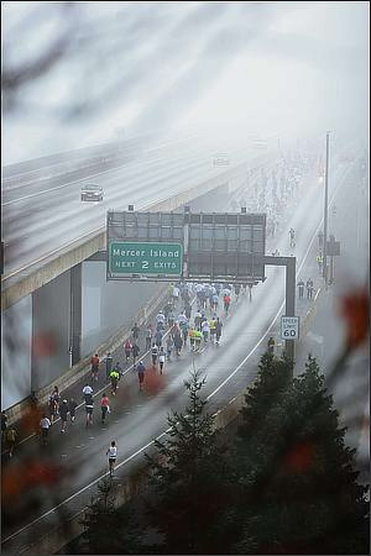 Runners make their way onto the I-90 floating bridge during in the 2008 Seattle Marathon.