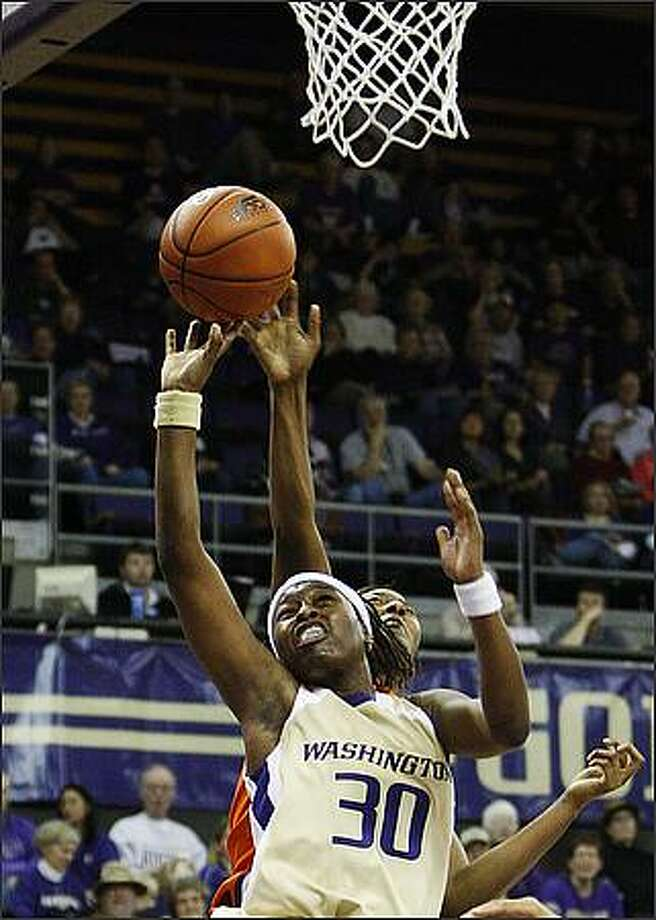 Washington's Lydia Young goes up for a shot during Sunday's championship game of the Husky Classic at Hec Edmundson Pavilion versus Clemson University. The Huskies lost the game 85-67. Photo: Brad Vest, Seattle Post-Intelligencer
