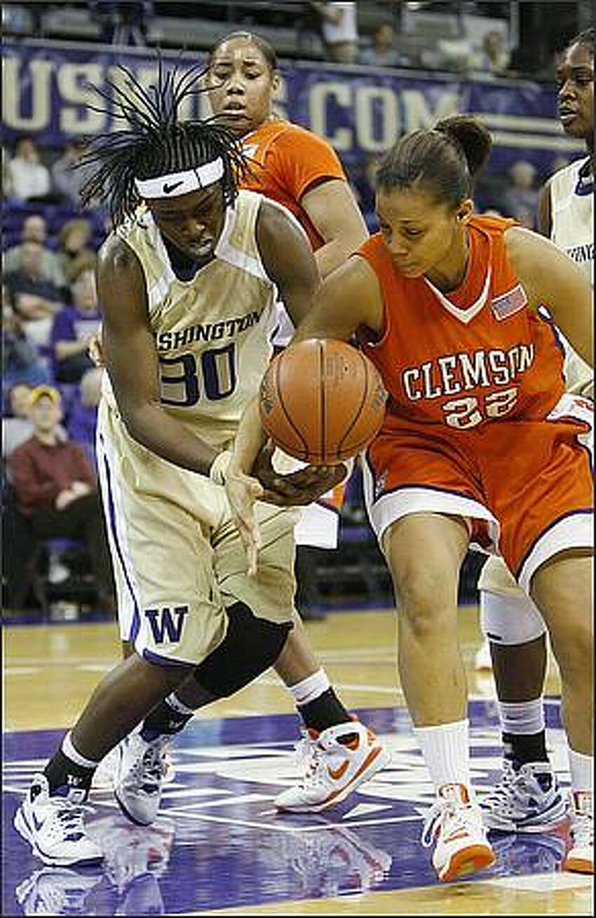 Washington's Lydia Young gets the ball knocked away from her by Clemson's Sthefany Thomas during Sunday's Husky Classic championship game.