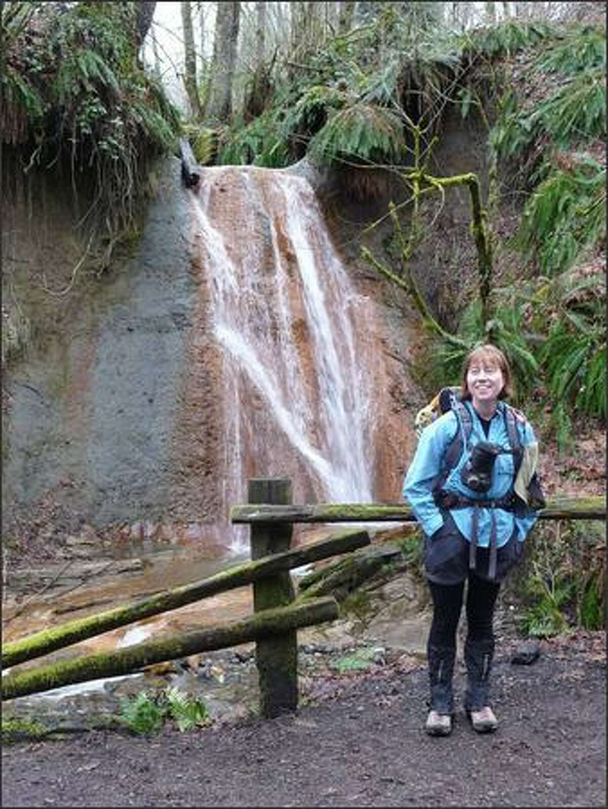 Kelly Cleman, a Snohomish resident and member of The Mountaineers, is in front of North Fork Falls.