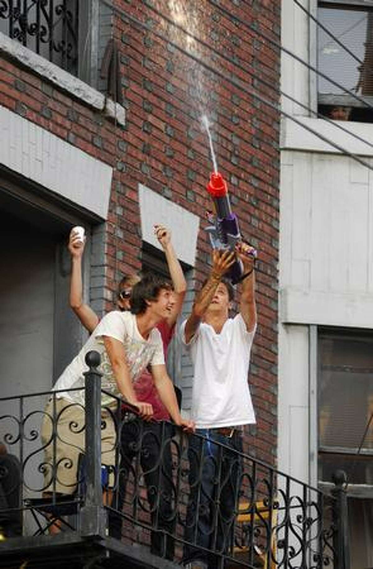 Capitol HIll Block Party attendees squirt water onto the crowd during Deerhunter's performance July 24.