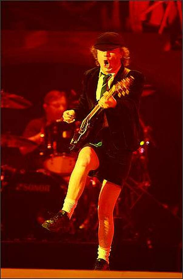 Angus Young out front with AC/DC as they perform at the Tacoma Dome. Photo: Scott Eklund, Seattle Post-Intelligencer