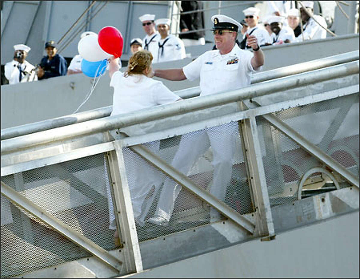 Fire Control Master Chief Danny Mercer, a 20-year Navy veteran, won the lottery to be first off the USS Camden -- and the first to get a kiss. He and his wife, Debbie, rewarded the crowd with a long smooch. Said Debbie Mercer afterward,