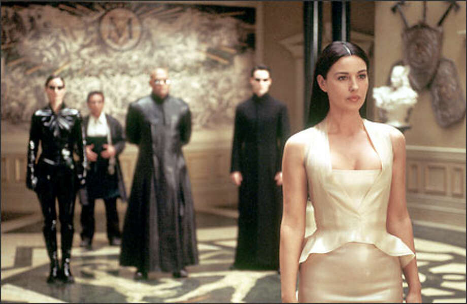 Trinity, the Keymaker, Morpheus, Neo and Persephone. Photo: Warner Brothers