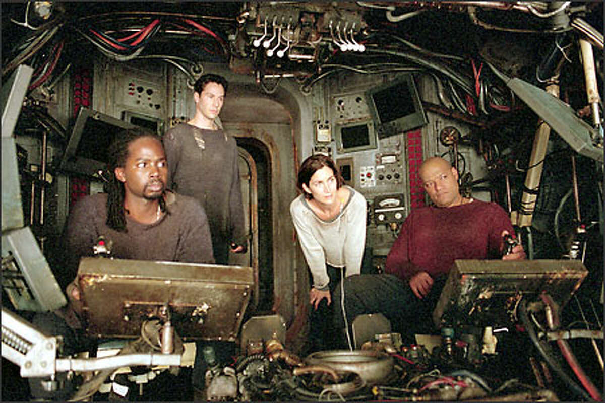 Aboard the Nebuchadnezzar: (l-r) Link (Harold Perrineau), (Keanu Reeves), Trinity (Carrie-Anne Moss) and Morpheus (Laurence Fishburne).