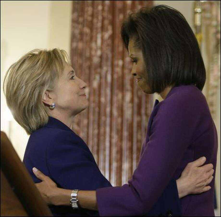 Secretary of State Hillary Clinton and first lady Michelle Obama embrace at the International Women of Courage Award Ceremony on Wednesday. Photo: Alex Brandon/Associated Press