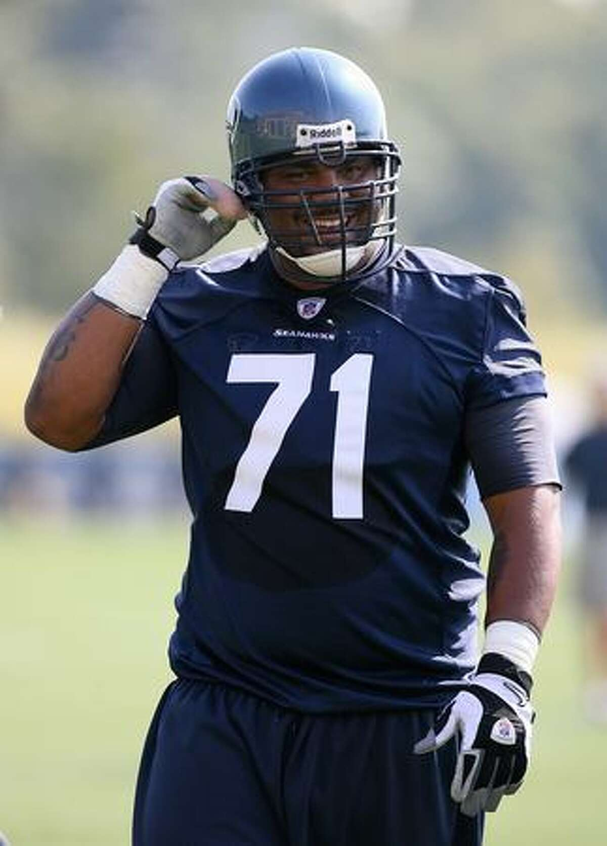 Tackle Walter Jones of the Seahawks smiles during training camp Friday.