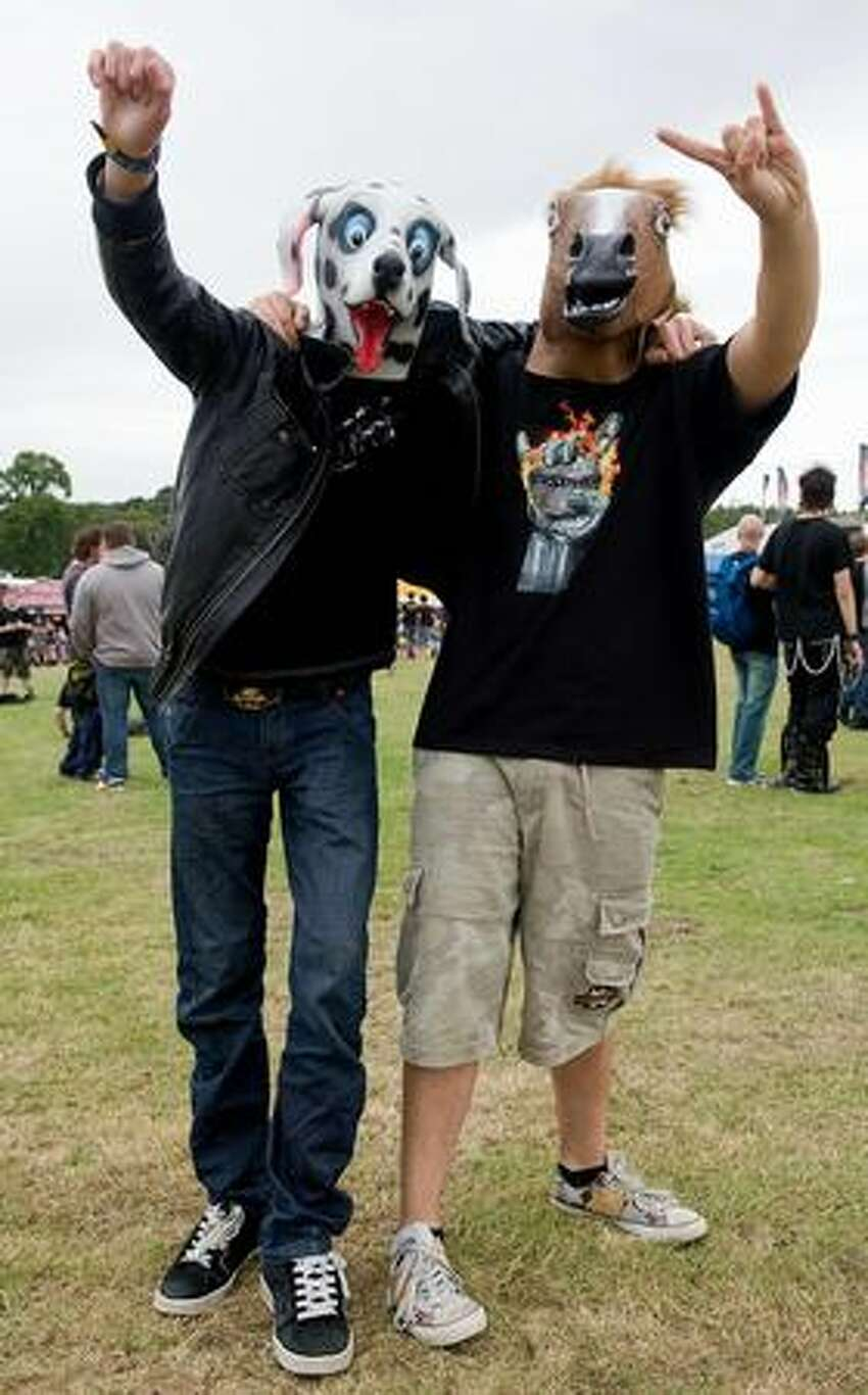 Two revellers wear animal masks at the Sonisphere rock festival at Knebworth, UK.