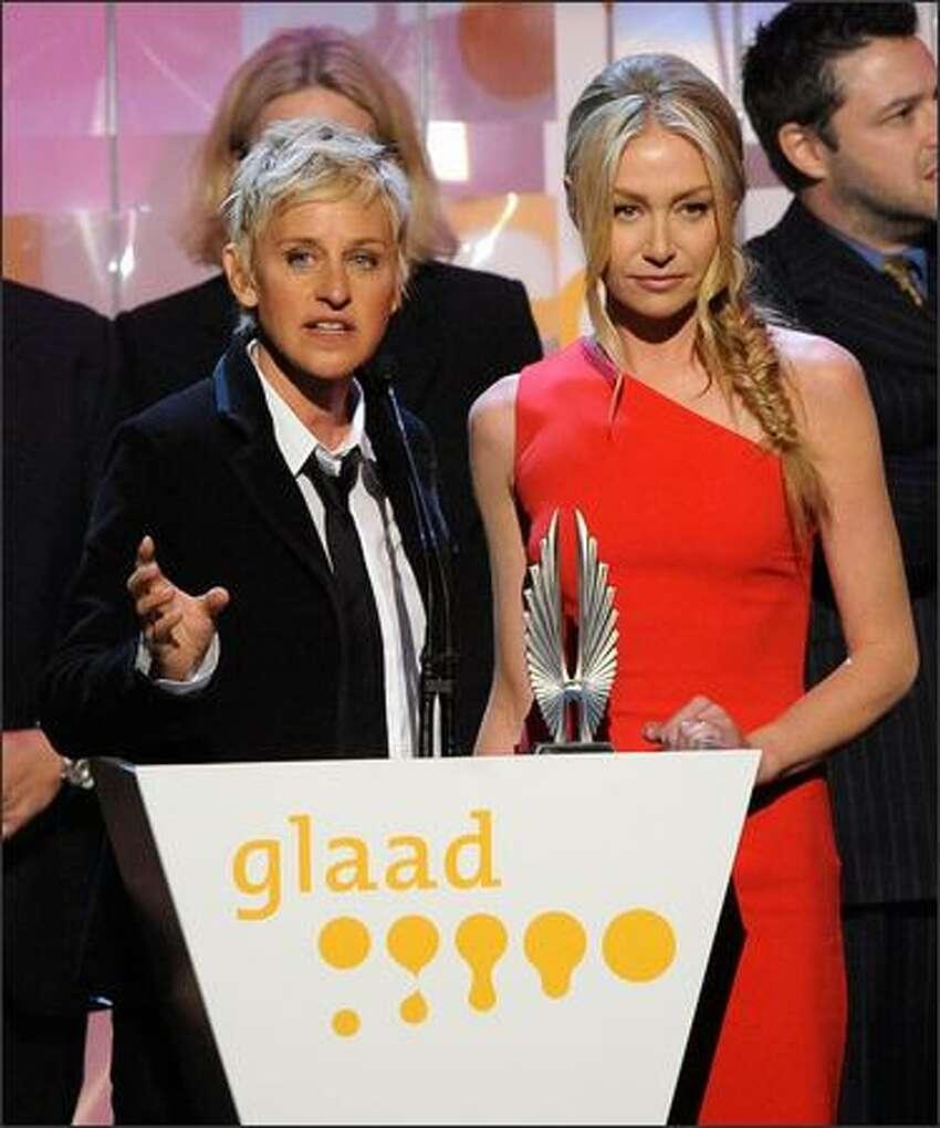 Actresses Ellen DeGeneres and Portia de Rossi speak onstage.