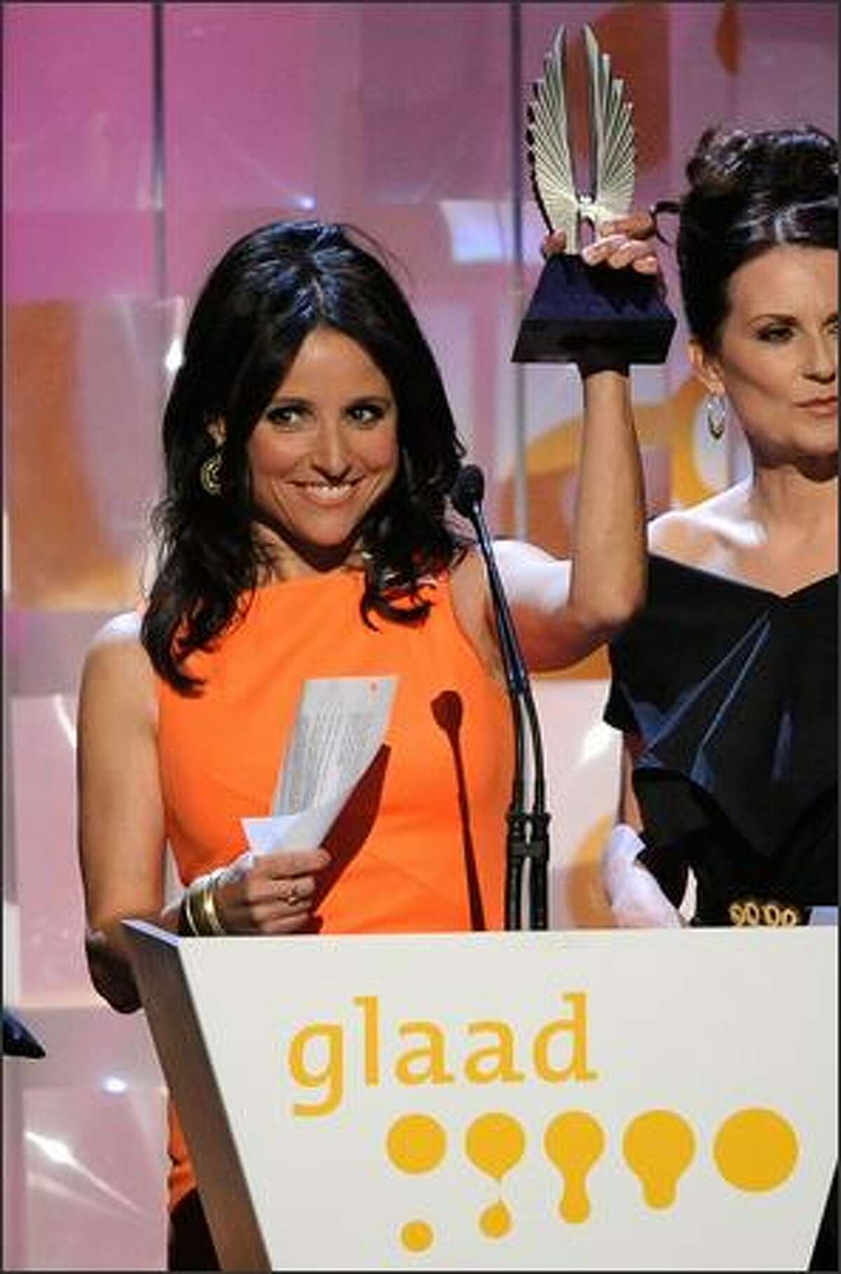 Actress Julia Louis-Dreyfus onstage.