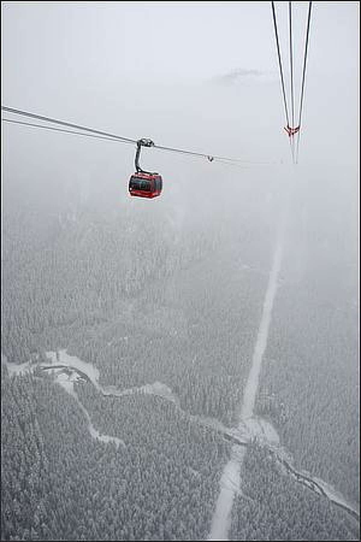 The Peak 2 Peak Gondola officially opens to the public, connecting Blackcomb and Whistler peaks.