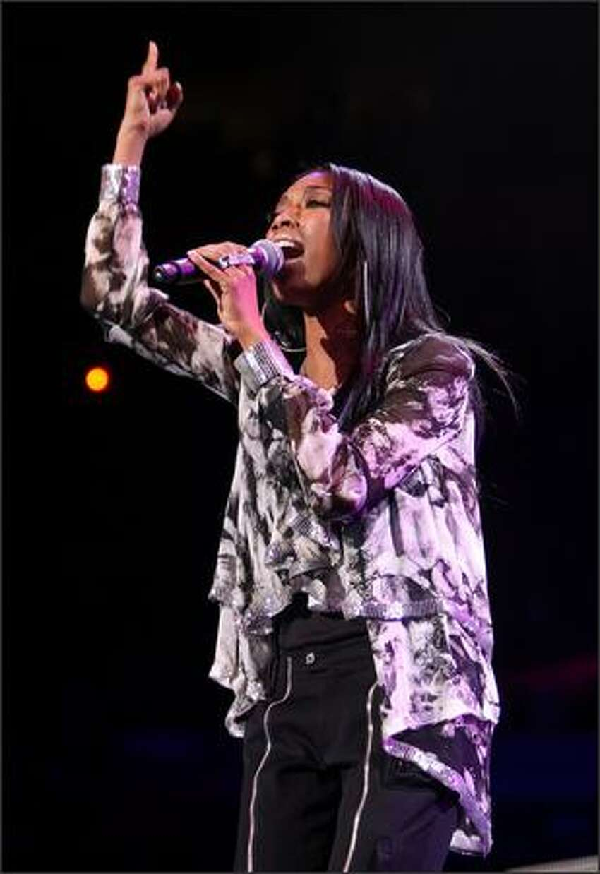 Singer Brandy performs on stage during Z100's Jingle Ball at Madison Square Garden in New York on Friday night.