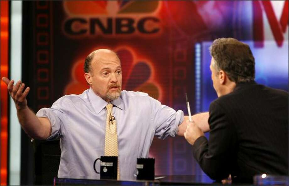 "Jim Cramer, left, host of ""Mad Money"" on CNBC, makes a point as he talks with Jon Stewart during an appearance on Comedy Central's ""The Daily Show with Jon Stewart"" Thursday in New York. (AP Photo/Jason DeCrow) Photo: / Associated Press"