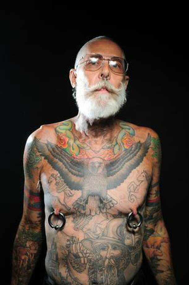 Dan Adcock poses for a portrait during day 1 of the Seattle Tattoo Expo at Seattle Center Friday August 7, 2009. The expo continues until Sunday evening. Photo by Daniel Berman/SeattlePI.com Photo: Daniel Berman, Seattlepi.com