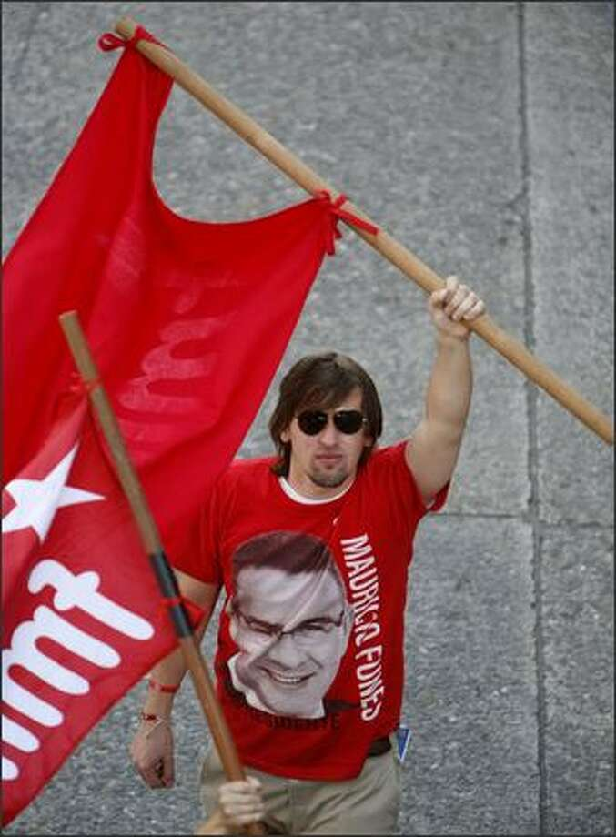 Marchers make their way through downtown Seattle during the annual May Day march. Photo: Joshua Trujillo, Seattlepi.com