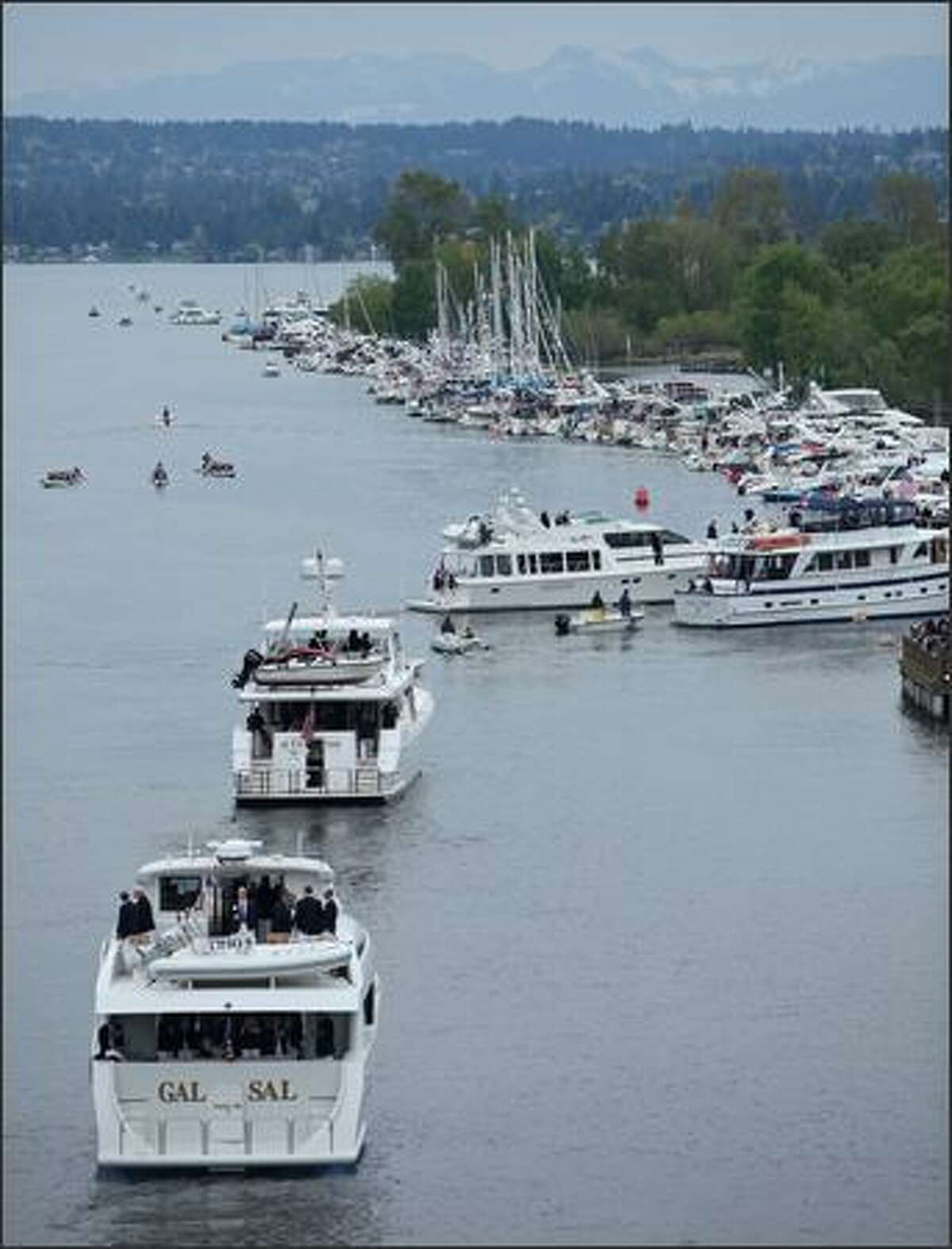 Boaters move around on Lake Washington during the opening of the boating season Saturday. (Tim Willis/seattlepi.com)