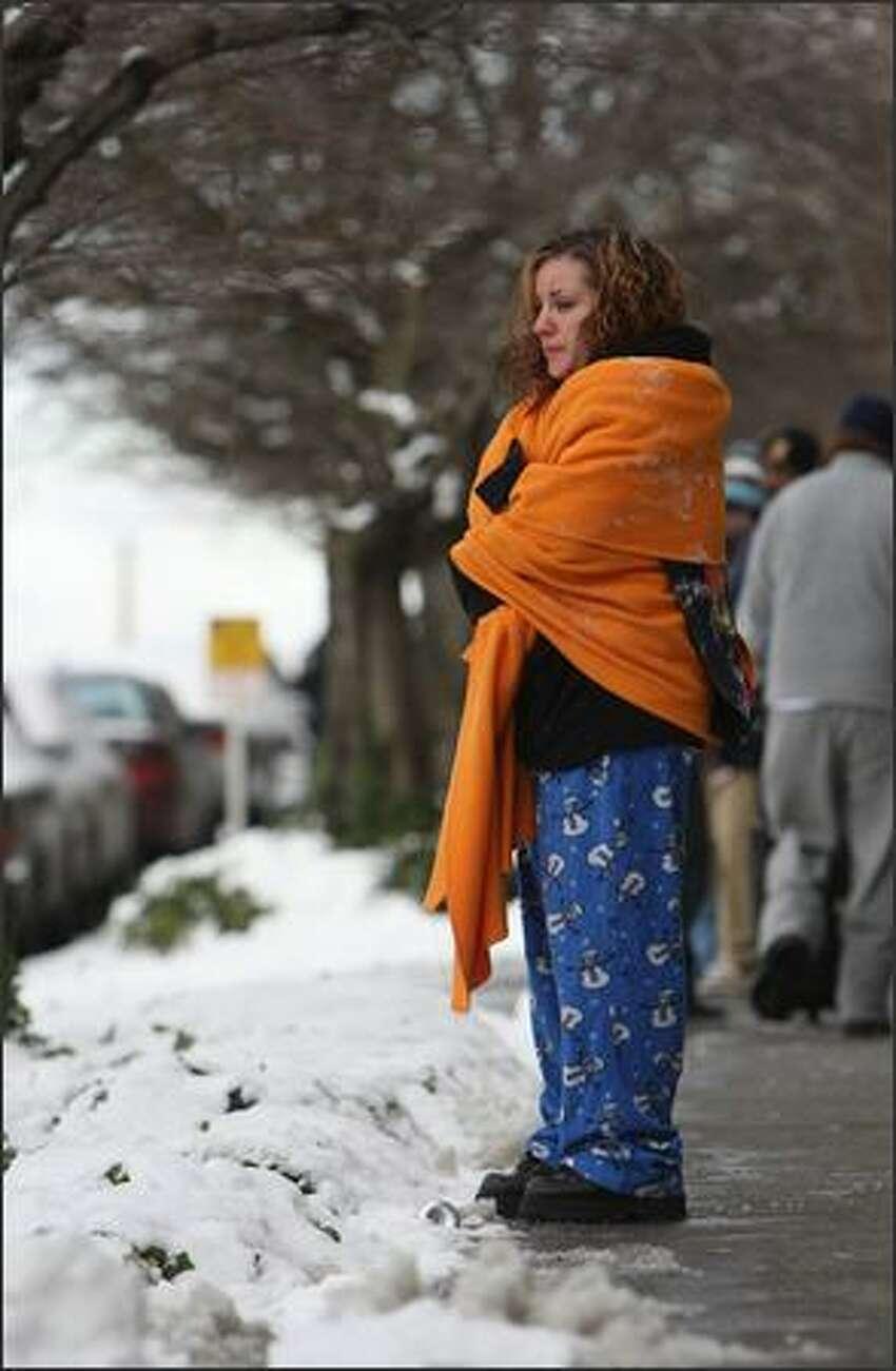 Passenger Sabrina Tate, of Spokane, looks at the scene.