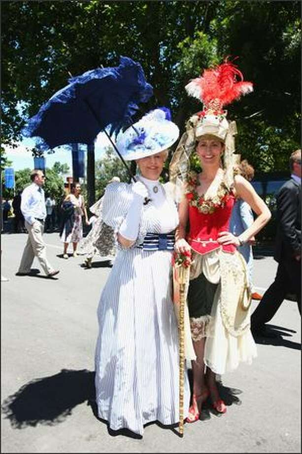 Carolyn Gibson (L) and Joelle March pose for a photo after registering for the Fashion in the Fields during the New Zealand Herald Christmas Carnival meeting at Ellerslie Racecourse on Friday in Auckland, New Zealand. Photo: Getty Images