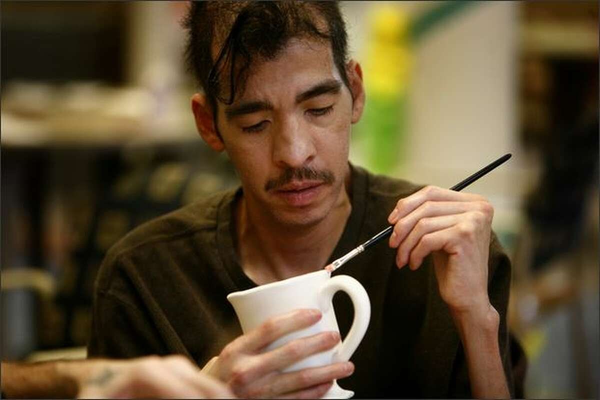 Mario Garcia, a client at the Bailey-Boushay House at Virginia Mason, works on an art project. The organization has been offering support for people with HIV and AIDS for nearly 17 years.