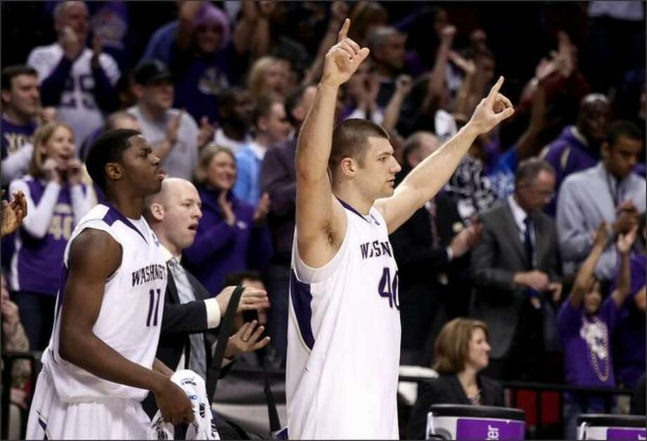 Jon Brockman and Matthew Bryan-Amaning (left) of the Huskies react from the bench while taking on Mississippi State. Photo: / Getty Images